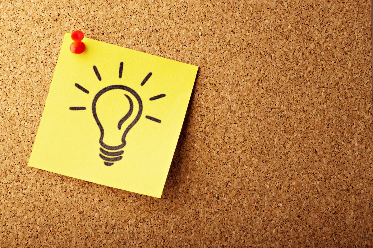 Lightbulb on a post-it note, representing an Idea